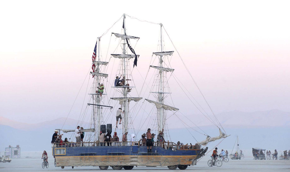 A sailboat art car drives across the playa at the Burning Man festival in Gerlach, Nev. on Friday, Aug. 30, 2013. Once a year