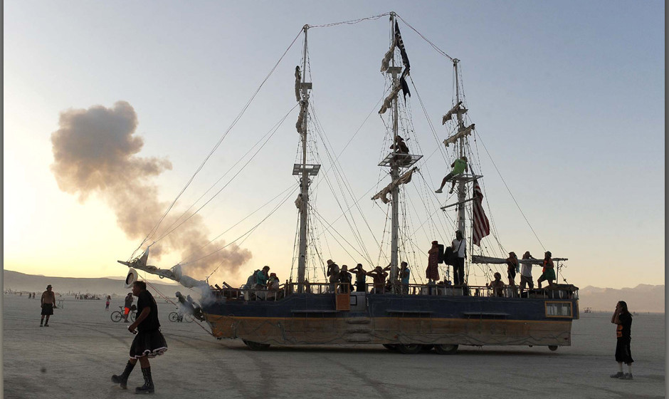 A sailboat art car fires off a round at the Burning Man festival in Gerlach, Nev. on Friday, Aug. 30, 2013. Once a year, tens
