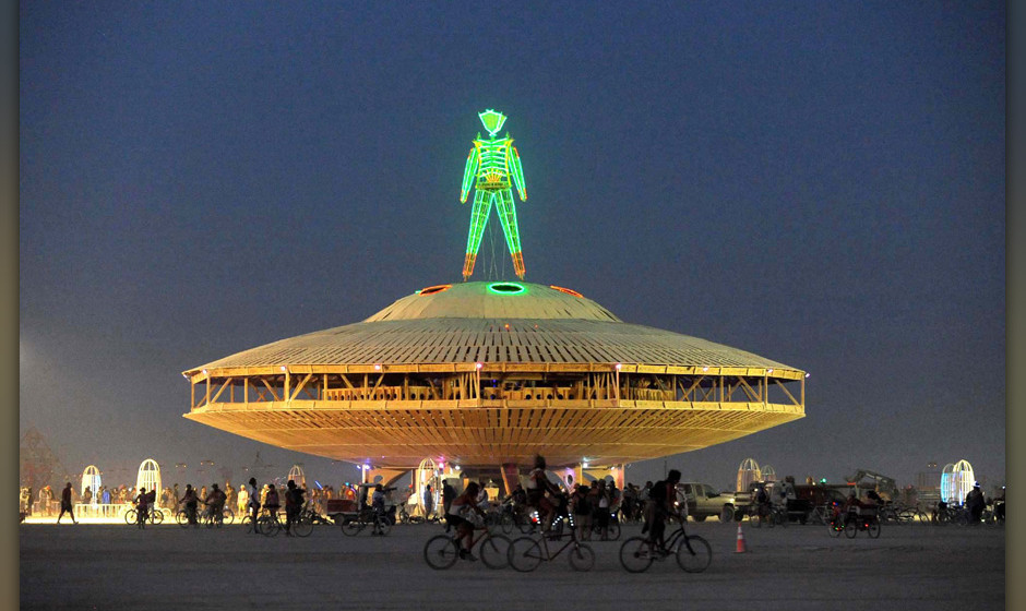 The 'Man' sculpture is illuminated after sunset at the Burning Man festival in Gerlach, Nev. on Friday, Aug. 30, 2013. Once a