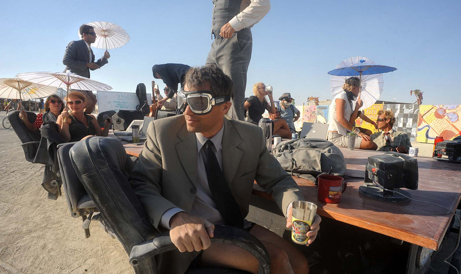A 'Mobile Board Room' moves along the playa at the Burning Man festival in Gerlach, Nev. on Thursday, Aug. 29, 2013. Once a y