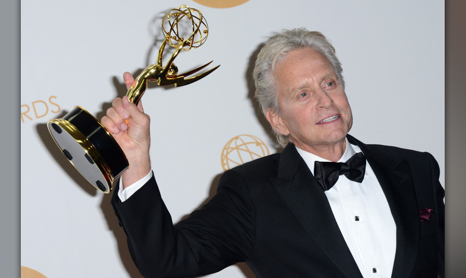 Michael Douglas, winner of the Best Lead Actor in a Miniseries or Movie Award for 'Behind The Candelabra' poses in the press