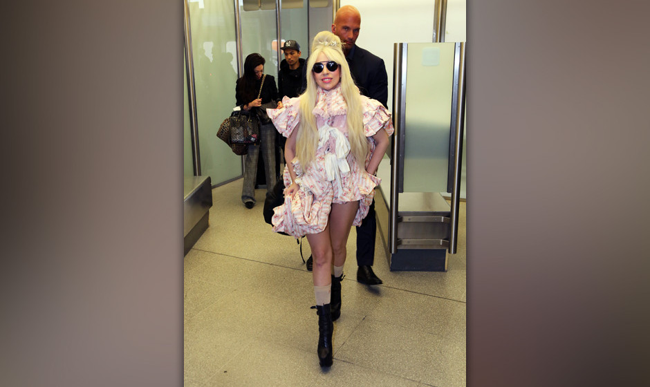 BERLIN, GERMANY - OCTOBER 23:  Lady Gaga arrives at Berlin-Tegel Airport on October 23, 2013 in Berlin, Germany.  (Photo by C