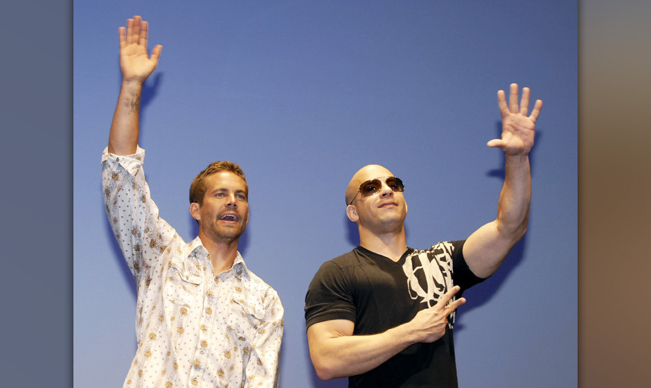 Image #: 8937098    Actors Paul Walker (L) and Vin Diesel (R), attend the Japanese premiere of the film 'Fast & Furious'