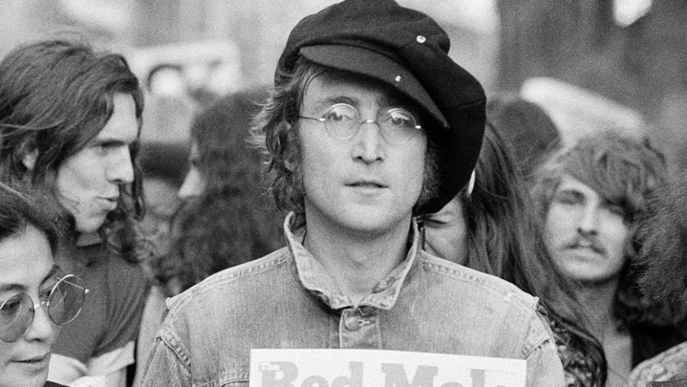 Portrait of British musician John Lennon (1940 - 1980) (center) and his wife, artist and musician Yoko Ono (extreme left) as