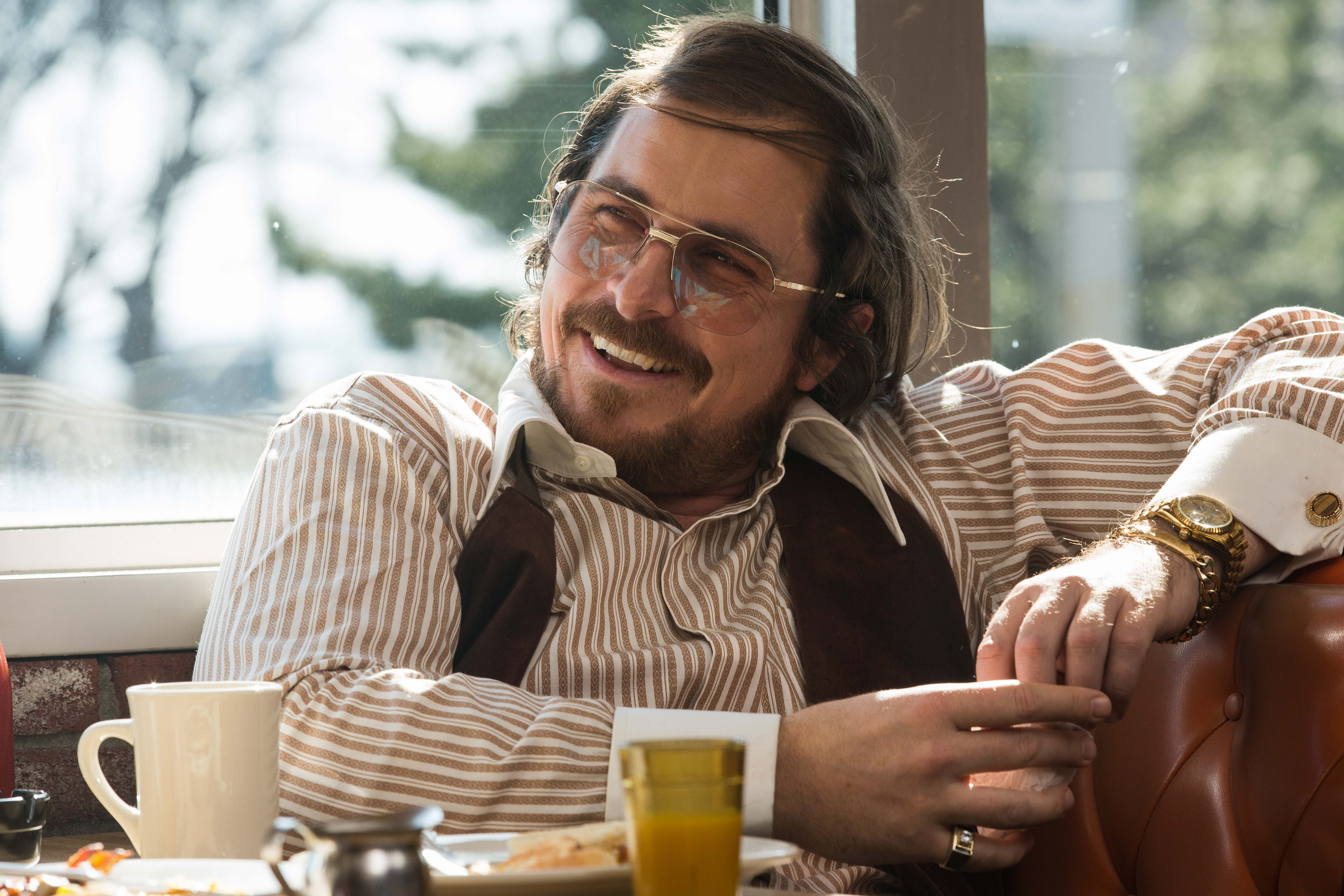 Christian Bale stars as Irving Rosenfeld  in Columbia Pictures' AMERICAN HUSTLE.