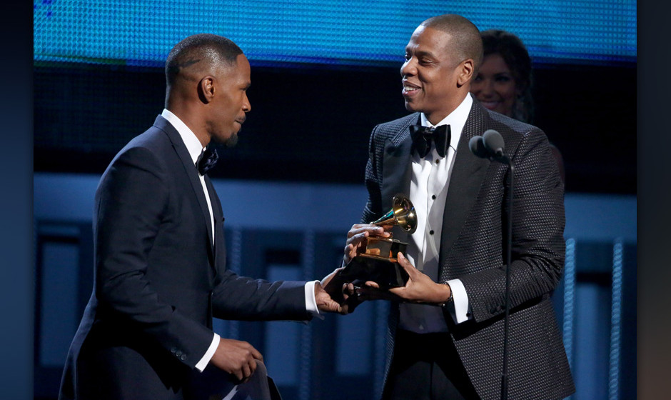 Jamie Foxx, left, presents Jay-Z with the award for best rap/sung collaboration at the 56th annual Grammy Awards at Staples C