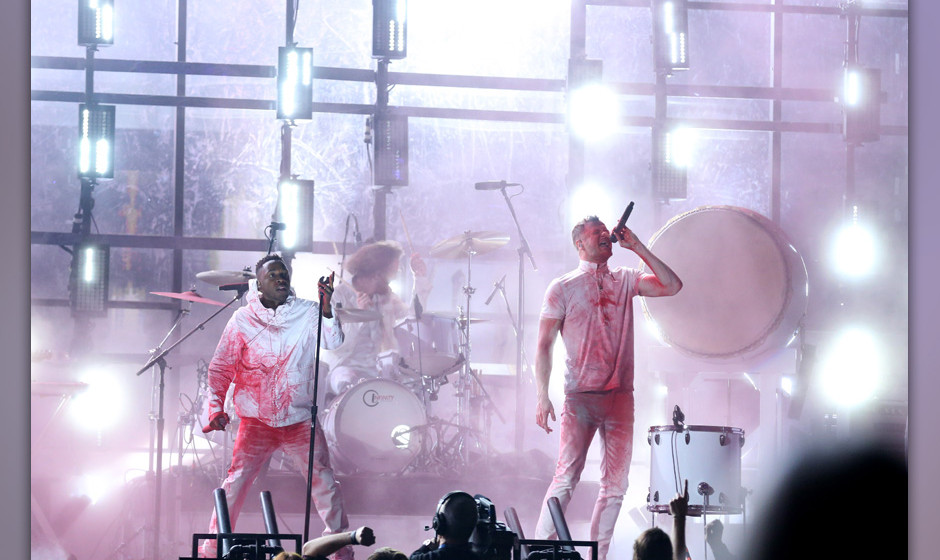 Kendrick Lamar, left, and Dan Reynolds of Imagine Dragons perform at the 56th annual Grammy Awards at Staples Center on Sunda