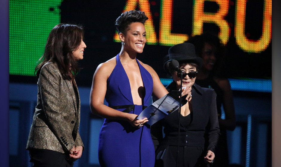 Olivia Harrison, from left, Alicia Keys and Yoko Ono speak on stage at the 56th annual Grammy Awards at Staples Center on Sun