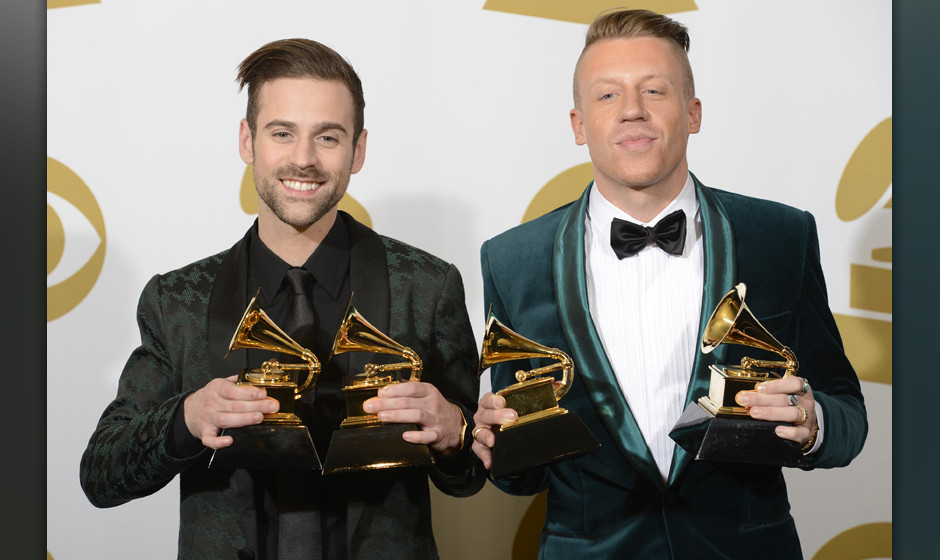 Image #: 26818249    Macklemore & Ryan Lewis hold the four Grammy Awards they won including Best New Artist and Best Rap