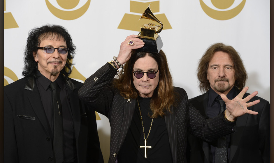Image #: 26816227    (L-R) Recording artists Tony Iommi, Ozzy Osbourne and Geezer Butler of Black Sabbath hold their Grammy A