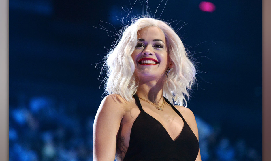 AMSTERDAM, NETHERLANDS - NOVEMBER 10:  Rita Ora presents the Best Hip Hop award to Eminem onstage during the MTV EMA's 2013 a