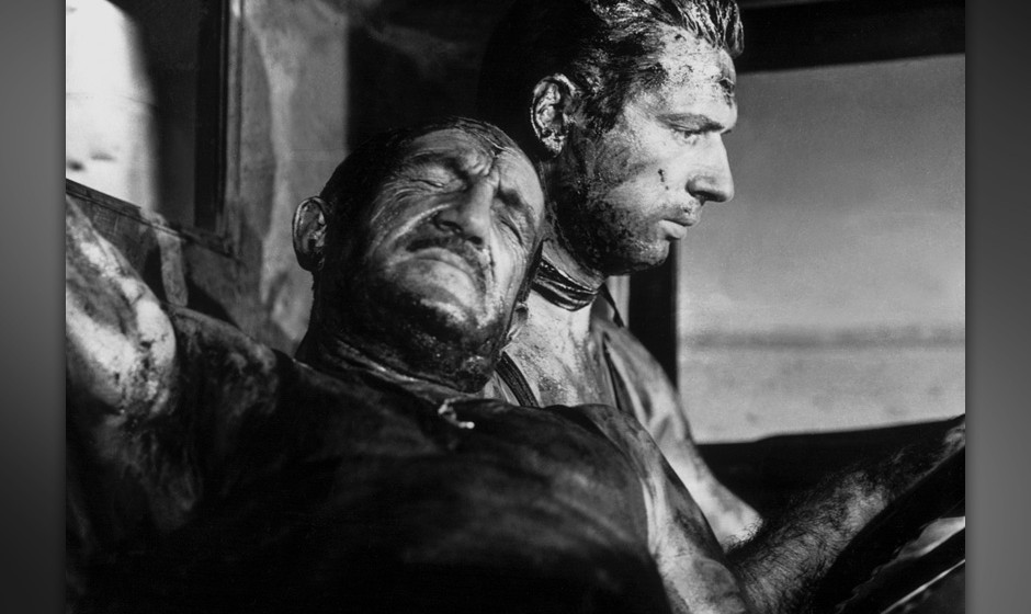 Charles Vanel(left) and Yves Montand (right) in Henri-Georges Clouzot's THE WAGES OF FEAR (1953). Courtesy Janus Films. Playi