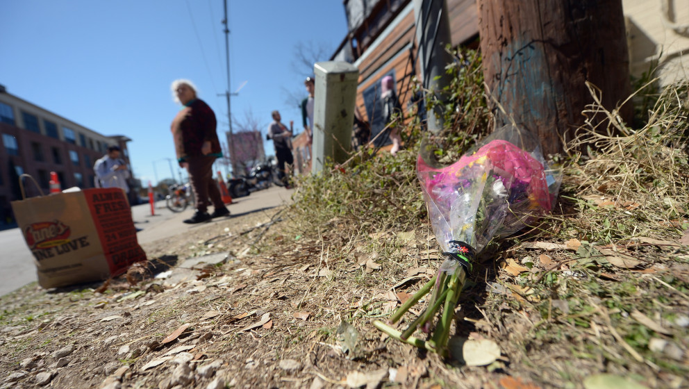 AUSTIN, TX - MARCH 13:  Flowers lie on the ground near the scene of a deadly car accident at the South by Southwest Music, Fi
