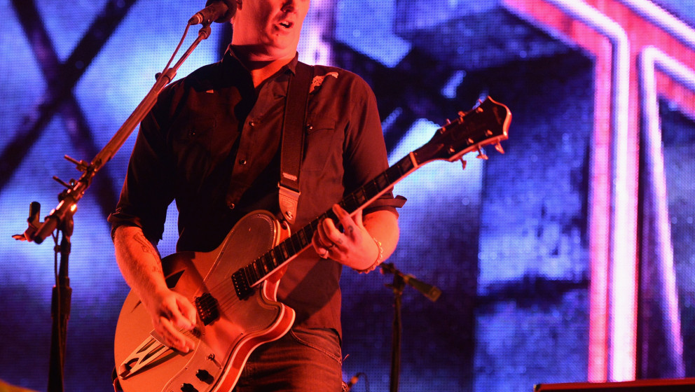 INDIO, CA - APRIL 12:  Musician Josh Homme of Queens of the Stone Age performs onstage during day 2 of the 2014 Coachella Val