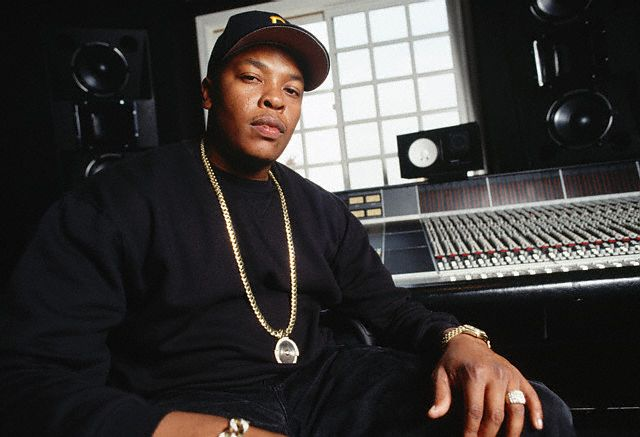 1994, Los Angeles, California, USA --- Rap artist Dr. Dre sits in front of recording equipment at his home in Los Angeles. --