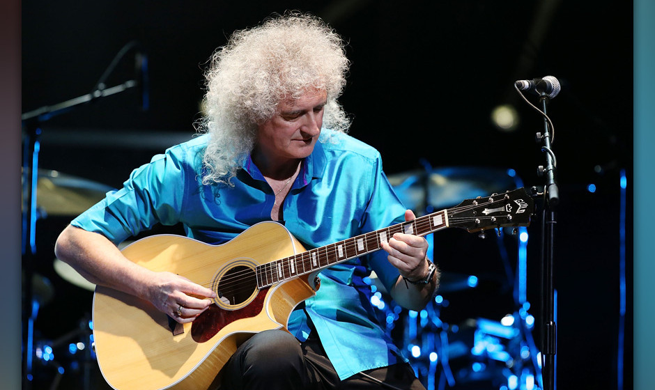 LONDON, ENGLAND - APRIL 01:  Brian May performs at City Rocks at the Royal Albert Hall, in support of Coram, the world's olde