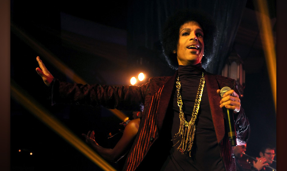 LOS ANGELES, CA - MARCH 08:  Prince performs onstage at The Hollywood Palladium on March 8, 2014 in Los Angeles, California.