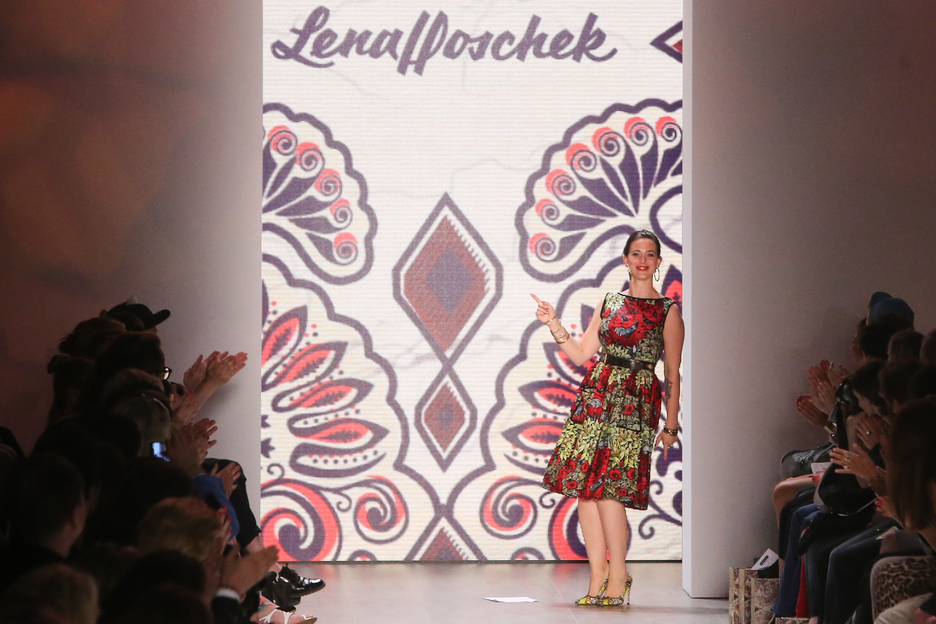 BERLIN, July 8, 2014 Austrian designer Lena Hoschek greets the audience during the Mercedes-Benz Fashion Week Berlin Spring/S