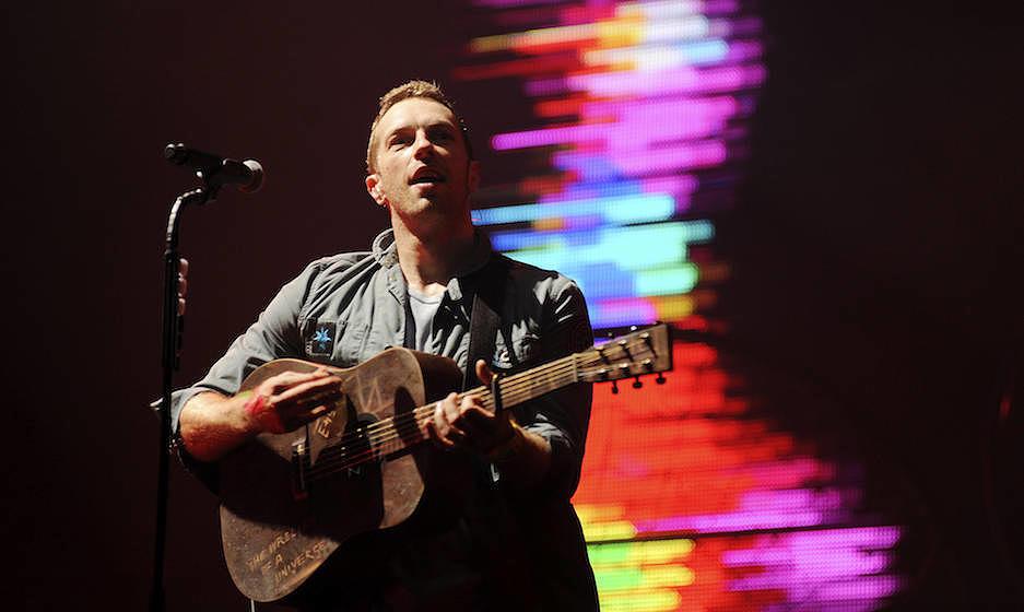 GLASTONBURY, UNITED KINGDOM - JUNE 25: Chris Martin of Coldplay headlines the Pyramid stage on the third day of Glastonbury F