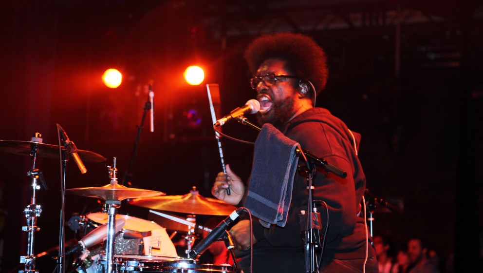 NEW YORK, NY - AUGUST 07:  Questlove of The Roots performs at the grand opening of the Guitar Center Times Square Flagship St