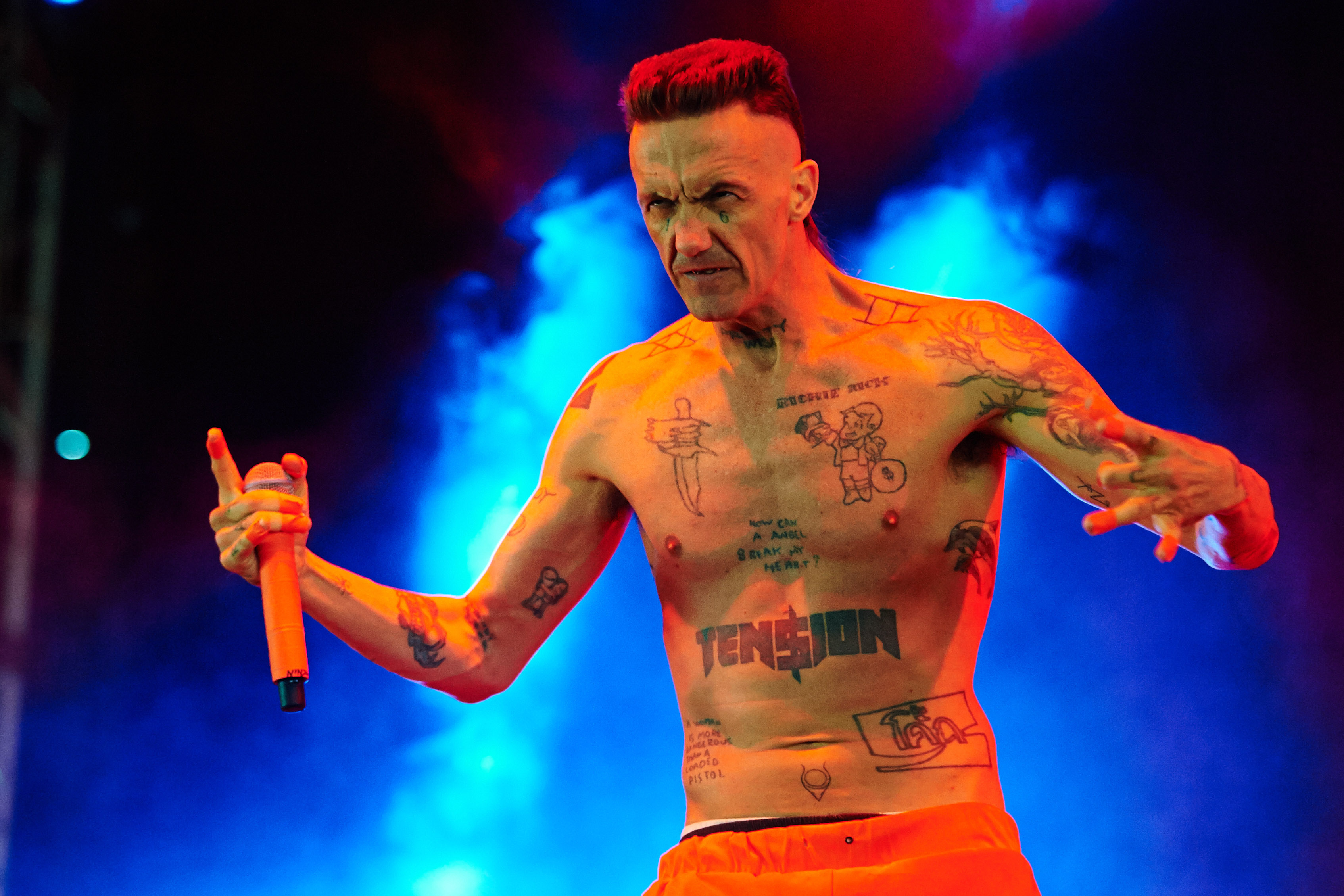 LEEDS, UNITED KINGDOM - AUGUST 24: Ninja of Die Antwoord performs on stage at Leeds Festival at Bramham Park on August 24, 20