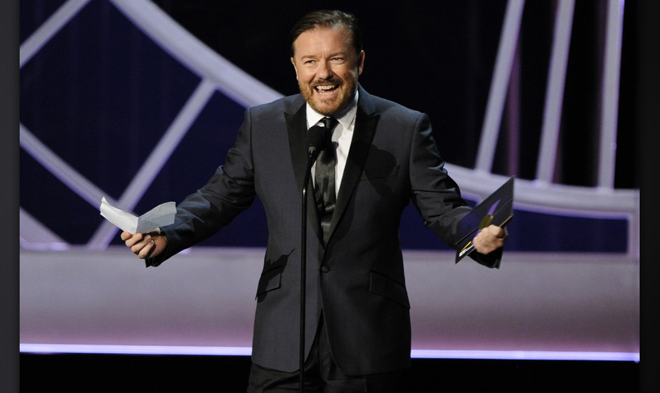 Ricky Gervais presents the award for outstanding writing for a variety, music or comedy special on stage at the 66th Annual P
