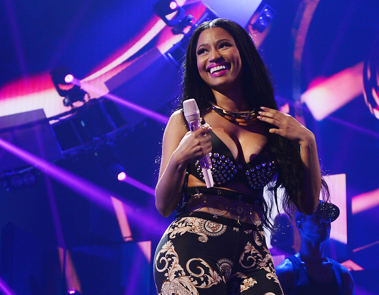 LAS VEGAS, NV - SEPTEMBER 19:  Recording artist Nicki Minaj (center) performs onstage during the 2014 iHeartRadio Music Festi
