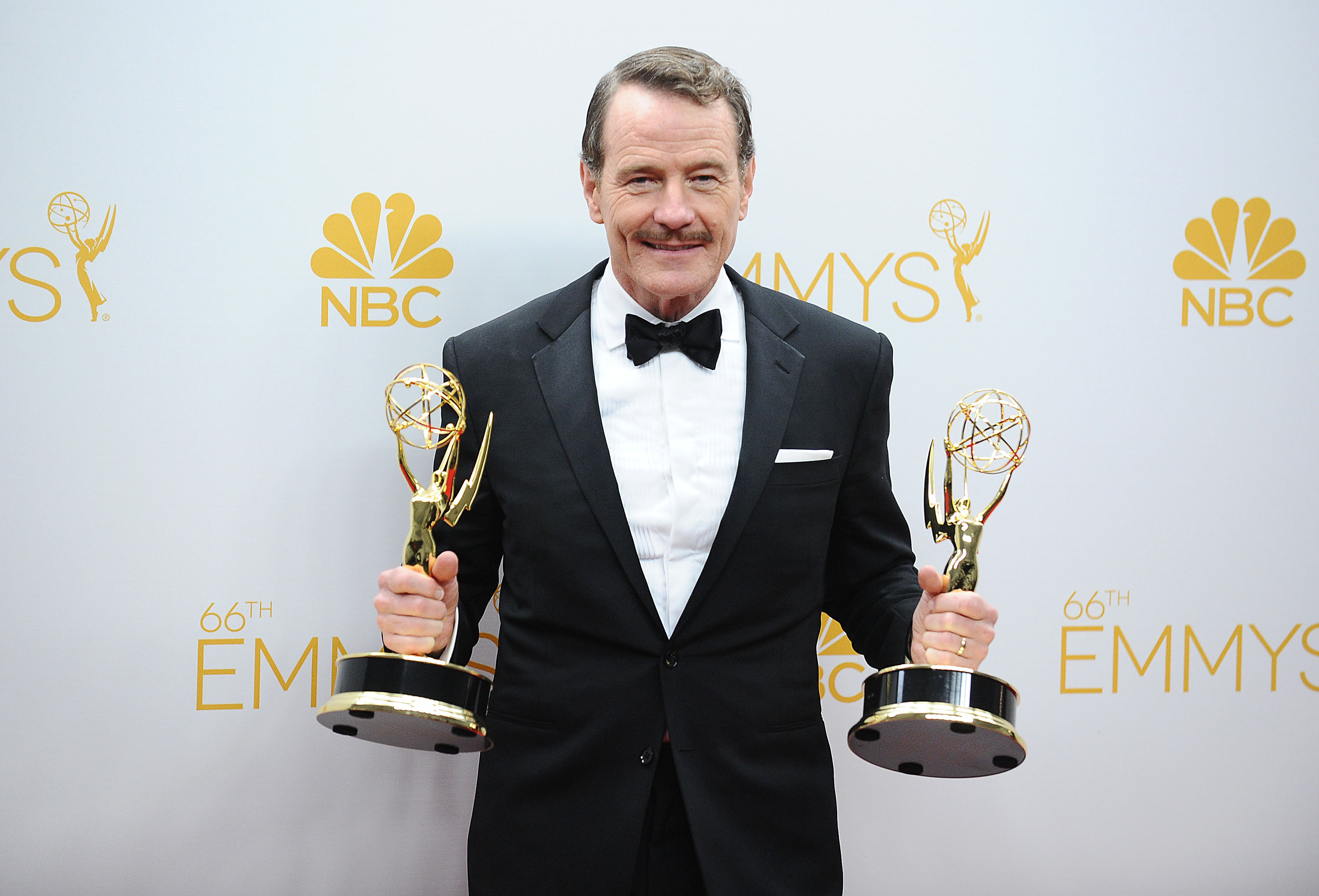LOS ANGELES, CA - AUGUST 25:  Actor Bryan Cranston poses in the press room at the 66th annual Primetime Emmy Awards at Nokia