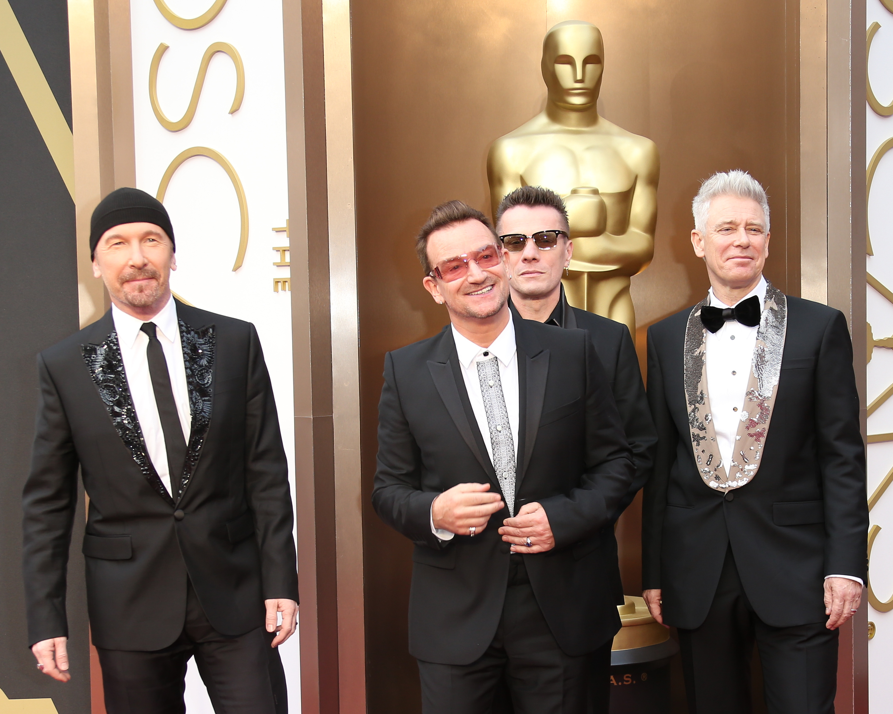 HOLLYWOOD, CA - MARCH 2: (L-R) The Edge, Bono, Larry Mullen, Jr. and Adam Clayton of 'U2' arrive at the 86th Annual Academy A