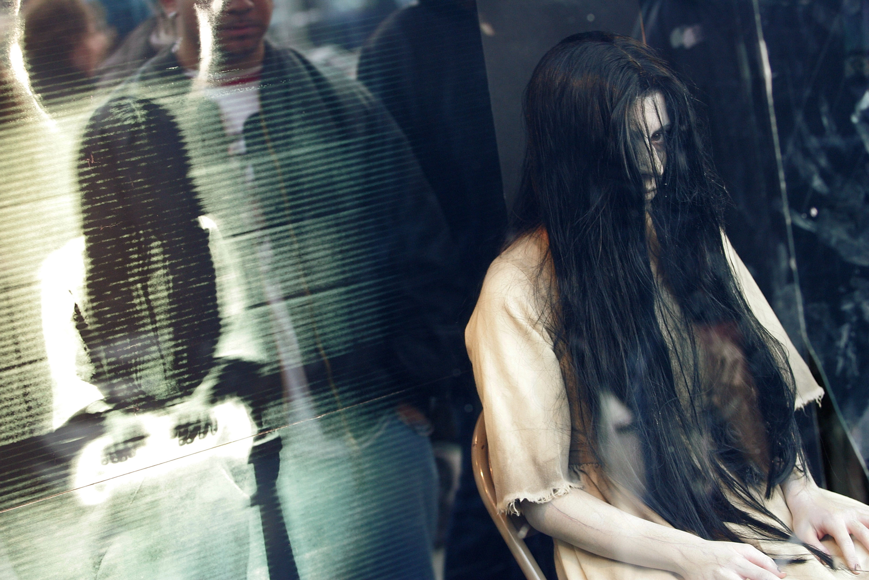 NEW YORK - MARCH 17: Samara from 'The Ring Two' stares out at pedestrians from a window during a promotion at the Virgin Mega