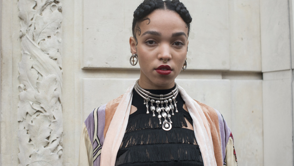 PARIS, FRANCE - JANUARY 22: Singer FKA Twigs wears a vintage kimono, Jean Paul Gaultier dress and jewellery on day 3 of Paris