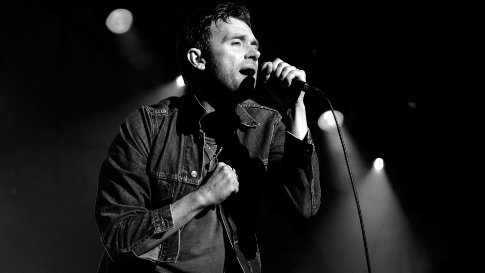 SOUTHWOLD, ENGLAND - JULY 19:  (EDITORIAL USE ONLY) (EDITORS NOTE: This image was converted to black and white) Damon Albarn