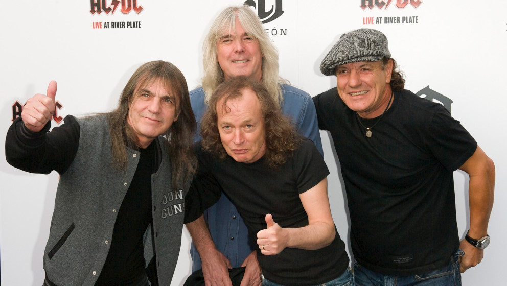 (L-R) AC/DC band members Malcolm Young, Cliff Williams, Angus Young and Brian Johnson attend the Exclusive World Premiere Of