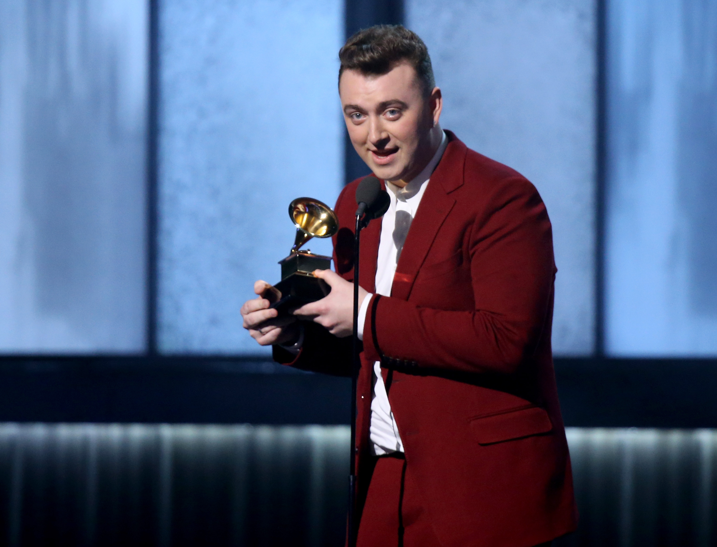 LOS ANGELES, CA - FEBRUARY 08:  Singer/songwriter Sam Smith accepts and award onstage during The 57th Annual GRAMMY Awards at