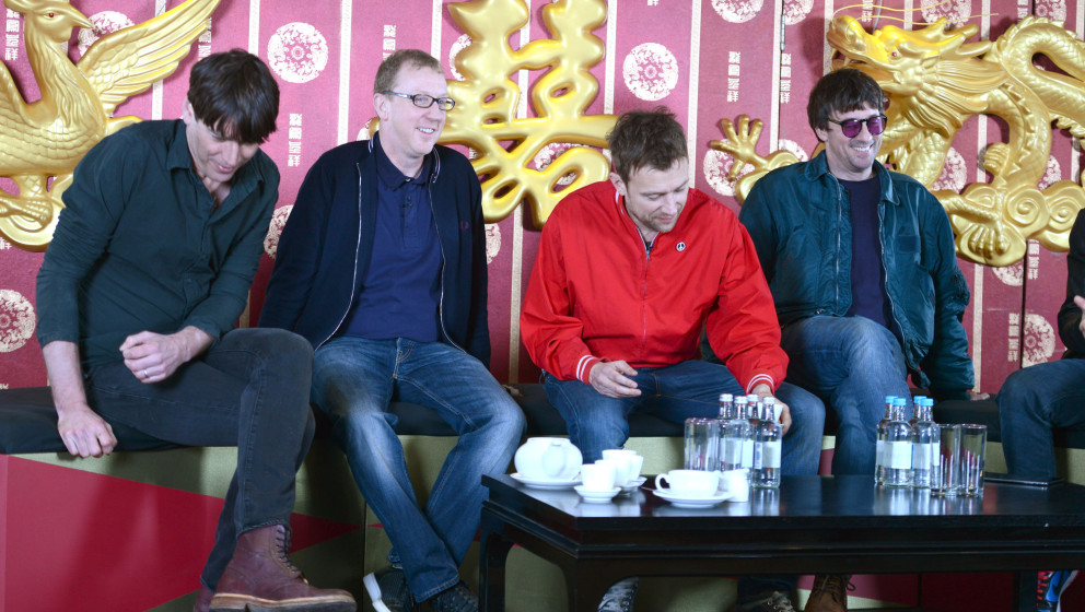 LONDON, ENGLAND - FEBRUARY 19:  Left-Right: Alex James, Dave Rowntree, Damon Albarn and Graham Coxon attend a photocall as Bl