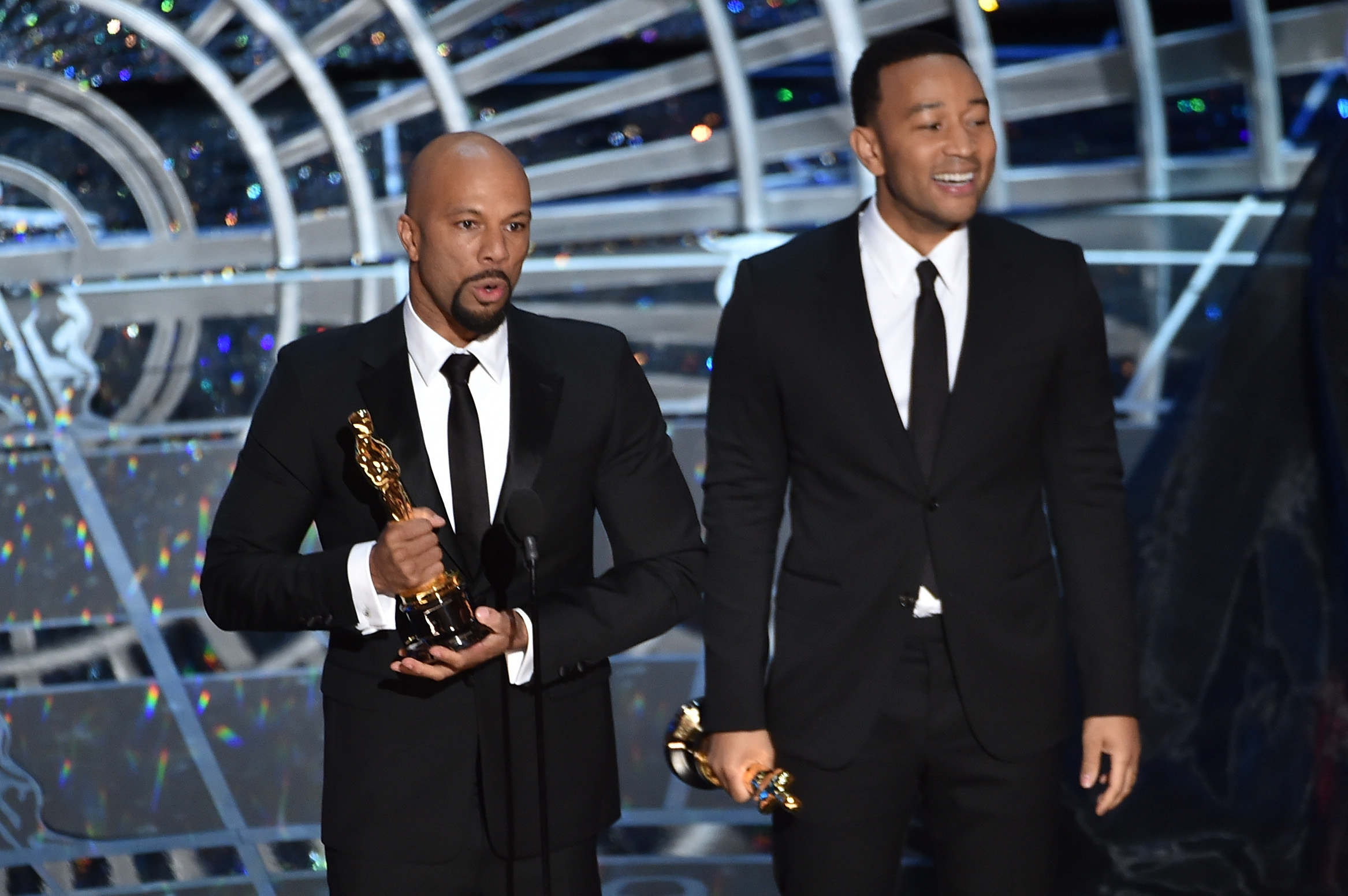 HOLLYWOOD, CA - FEBRUARY 22:  Musicians Common (L) and John Legend accept the Best Original Song Award for 'Glory' from 'Selm