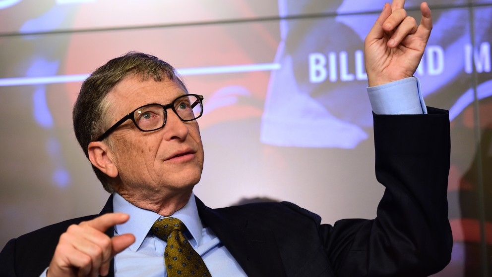 Bill Gates, founder of the Bill and Melinda Gates Foundation, gestures as he takes part in a discussion organised by British