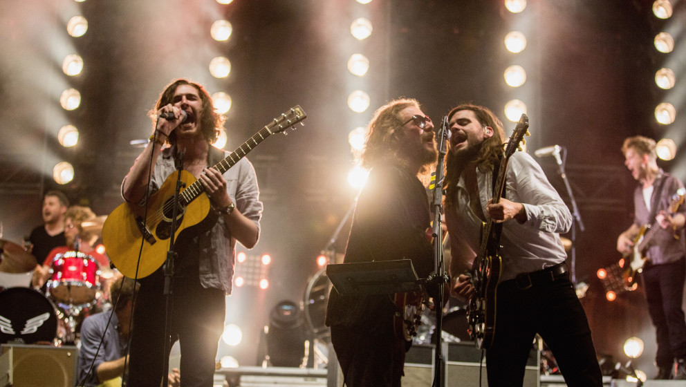 MANCHESTER, TN - JUNE 13: (L-R) Marcus Mumford, Jim James of My Morning Jacket and Winston Marshall of Mumford & Sons per