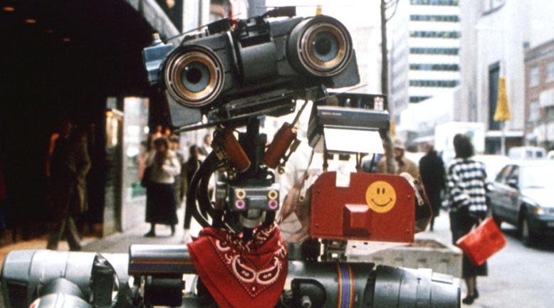 Nummer 5 lebt! (1986)  Der liebenswerte Militärroboter Nummer 5 flieht nach einem Blitzschlag vor seinen Erfindern, die ihn