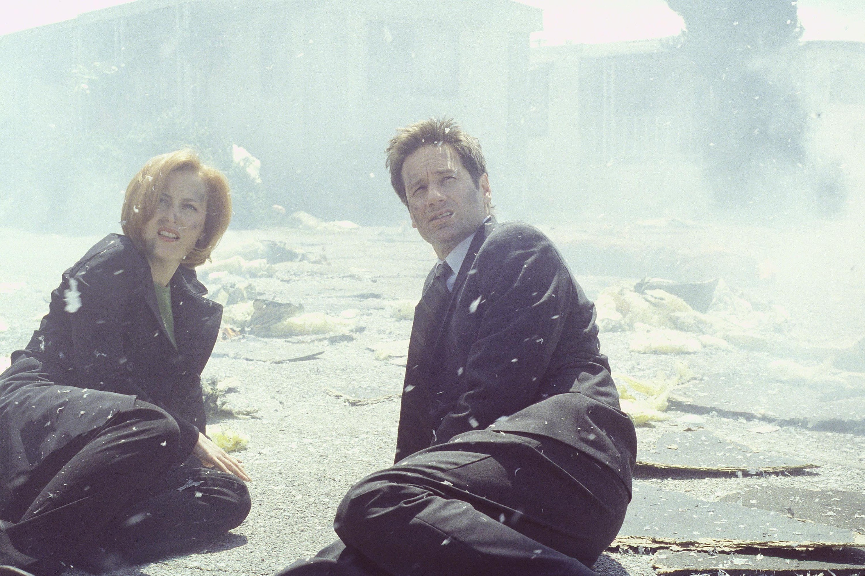THE X-FILES - SEASON 7:  Agents Scully (Gillian Anderson, L) and Mulder (David Duchovny, R) witness the repercussions of an u