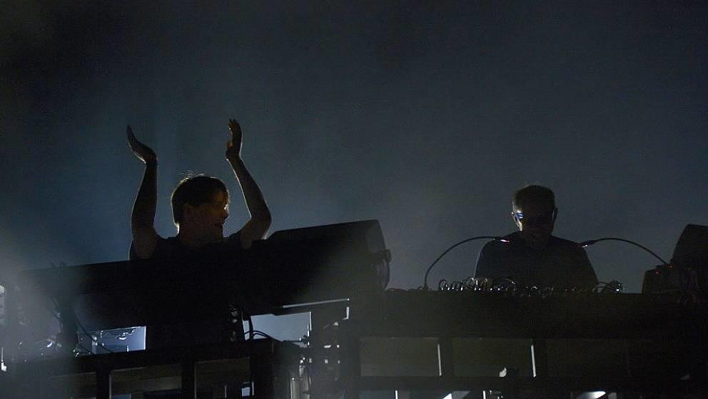 Tom Rowlands (L) and Ed Simons, of the British electronic music duo The Chemical Brothers perform during the Rock-en-Seine mu