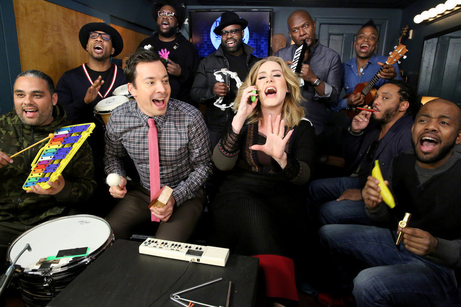 THE TONIGHT SHOW STARRING JIMMY FALLON -- Episode 0374 -- Pictured: (l-r) Host Jimmy Fallon and The Roots sing with Adele dur