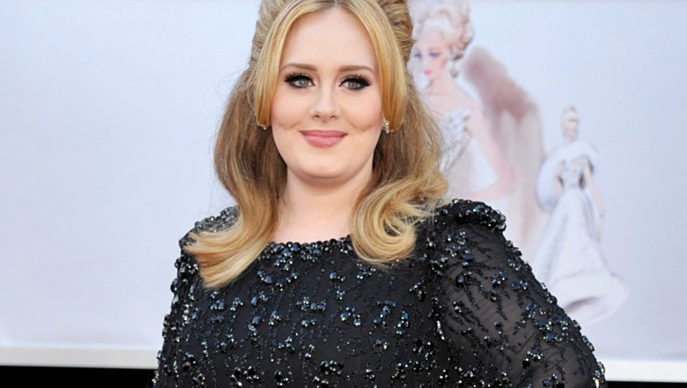 FILE - In this Feb. 24, 2013 file photo, singer Adele arrives at the Oscars in Los Angeles. Adele's new album '25' has sold m