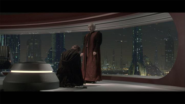 Anakin kniet vor Palpatine nieder, der seinem Schüler einen neuen Namen gibt: Darth Vader.