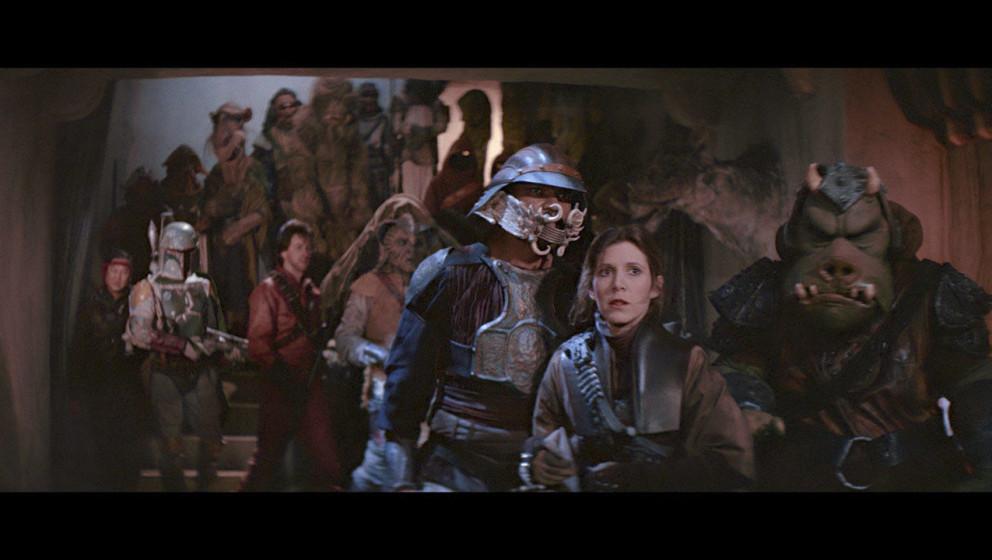 Es stellt sich heraus, dass Boushh in Wahrheit Leia ist. Jabba hat das Treiben allerdings im Hintergrund beobachtet und nimmt