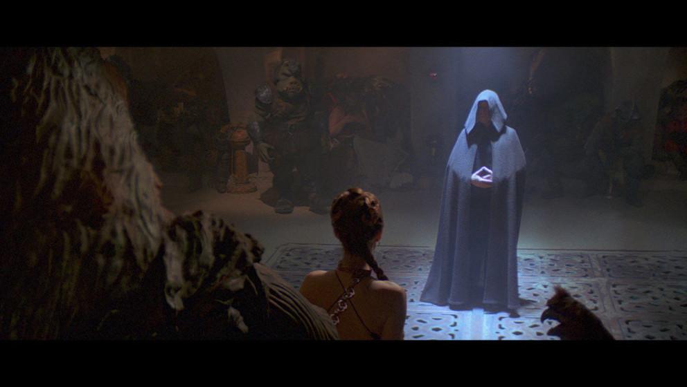Luke Skywalker trifft in Jabbas Palast ein und sagt ihm, dass er seine Freunde freilassen soll. Jabba lacht und durch eine Fa