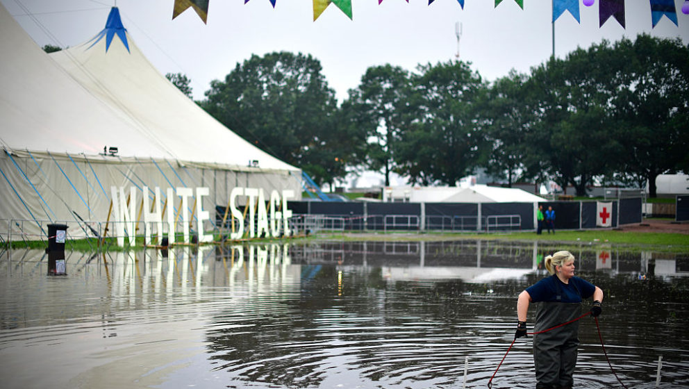 SCHEESSEL, GERMANY - JUNE 25: A member of the German Technical Emergency Service (THW) stands in a puddle in front of the Whi