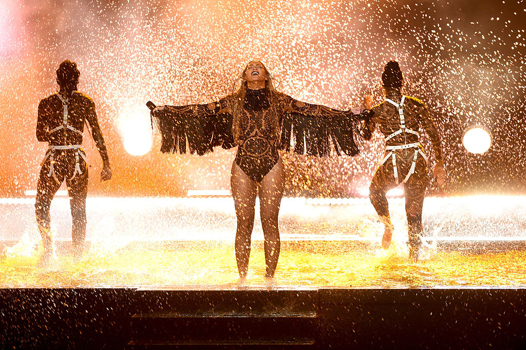 LOS ANGELES, CA - JUNE 26:  Recording artist Beyonce (C) performs onstage during the 2016 BET Awards at the Microsoft Theater