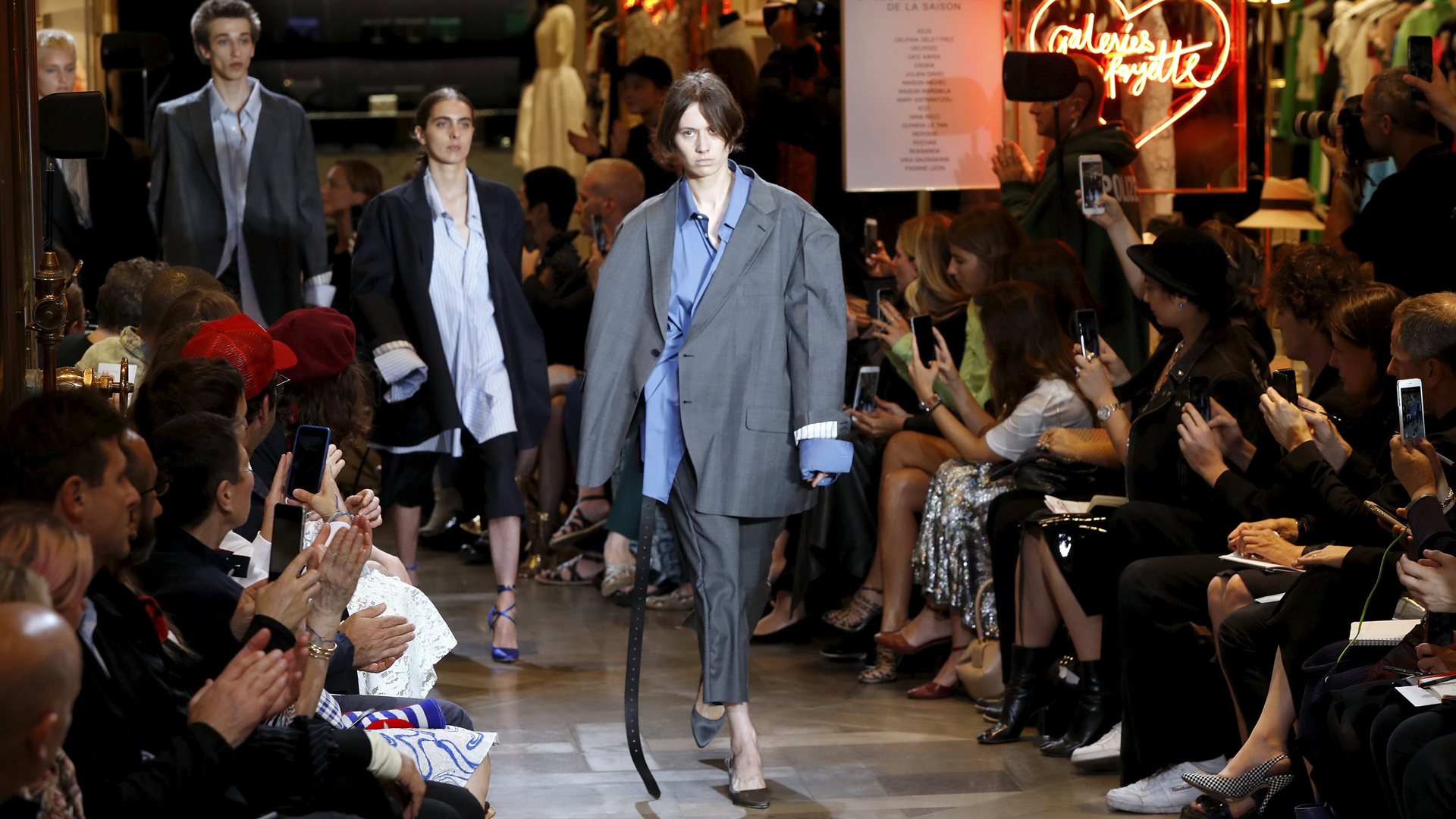 Models present creations for Vetements during the 2016-2017 fall/winter collection fashion show on July 3, 2016 in Paris. / A