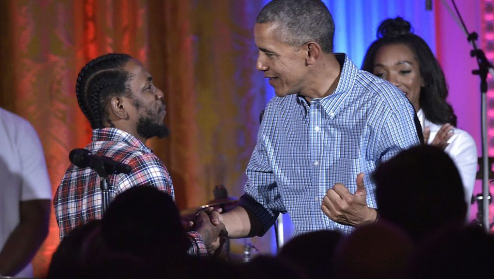 US President Barack Obama shakes hands with peformer Kendrick Lamar during an Independence Day Celebration for military membe